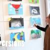Amandine Polet devant les dessins / collages réalisés pour l'exposition Je m'en souviens pour vous, autour du thème du souvenir